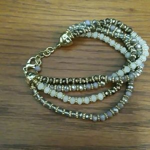 Gold and brown tones clasp bracelet